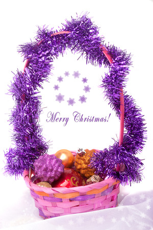 Christmas composition with a basket of baubles and snowflake pattern photo