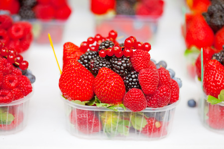 A box of bright fresh berries on a market stall photo