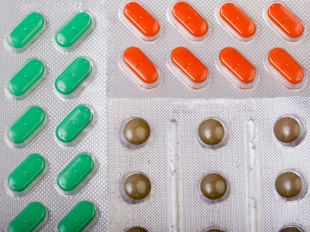 troche: Three types of pills as a background Stock Photo