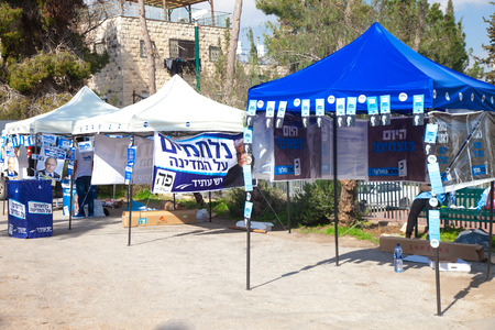slogans: JERUSALEM - MARCH 17: Campaign tents with slogans and symbols of various parties: Its us or them, Today we win, and We fight for the country during parlament elections day in Israel on March 17, 2015 Editorial