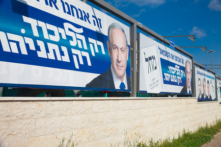 governing: JERUSALEM - MARCH 17: A set of street campaign billboards for Israeli governing party called Likud with slogans Likud only. Netanyahu only during parlament elections day in Israel on March 17, 2015