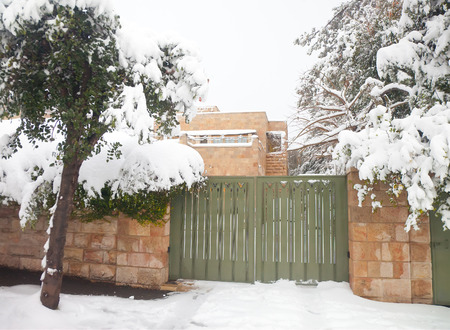 anomalies: JERUSALEM - FEBRUARY 20: Residence of the mayor of Jerusalem blocked with snow during a massive snowfall in Jerusalem on February 20, 2015