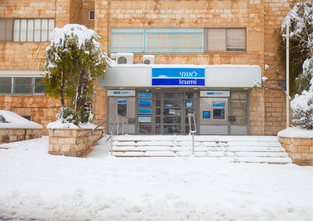 JERUSALEM - FEBRUARY 20: The entrance in a local branch of the Leumi bank in Jerusalem blocked with snow during a massive snowfall in Jerusalem on February 20, 2015