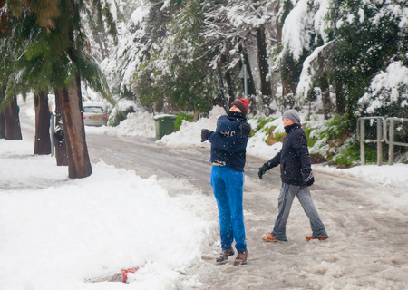anomalies: JERUSALEM - FEBRUARY 20: Happy teenagers playing with the snowflakes during a massive snowfall in Jerusalem on February 20, 2015 Editorial