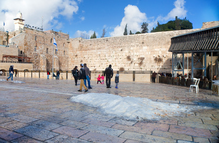 JERUSALEM - FEBRUARY 21: People coming to the Wailing Wall a day after a massive snowfall in Jerusalem, Israel on February 21, 2015 Editorial