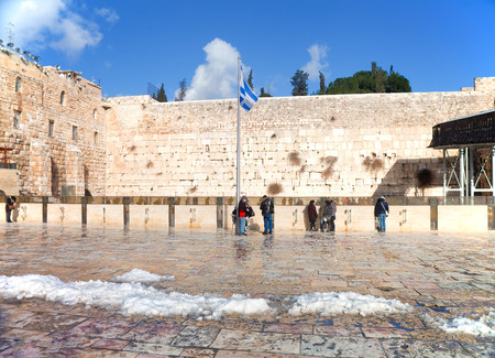 anomalies: JERUSALEM - FEBRUARY 21: The square in front of the Wailing Wall a day after a massive snowfall in Jerusalem, Israel on February 21, 2015