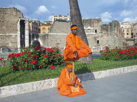 yogi: Rome - May 5, 2013: Street performers perform a Flying Yogi act in a street of Rome