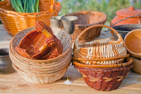 craft material: Natural material wicker folk craft baskets on wooden table