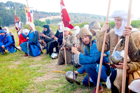 reenact: TSIPORI, ISRAEL - JULY 7, 2014: Crusader army line up for morning prayer. Battle of Hattin history reenactment event of 2014. Battle of Hattin is the last battle of the Crusaders Kingdom of Jerusalem marking its fall in 1187. Editorial