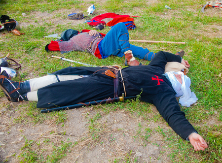 reenact: TSIPORI, ISRAEL - JULY 7, 2014: Crusade warriors resting before long march. Battle of Hattin history reenactment event of 2014. Battle of Hattin is the last battle of the Crusaders Kingdom of Jerusalem marking its fall in 1187.