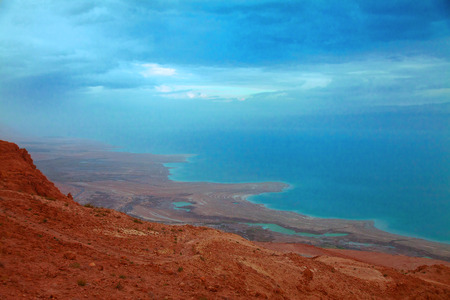 dead: The sunrise view on the shoreline of Dead Sea under heavy clouds Stock Photo