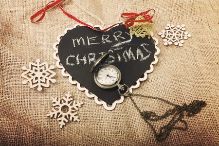 Vintage Merry Christmas and New Year concept with varios decorations and pocket watch (vintage toning) Stock Photo