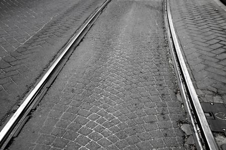 tramway: Old tramway railway on cobblestone street Stock Photo