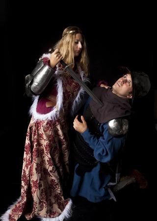 treacherous: Studio shot of a medieval style scene with a beautiful noble princess killing a treacherous knight