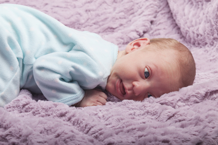 puzzled: Cute newborn redhead baby with puzzled expression on her face Stock Photo
