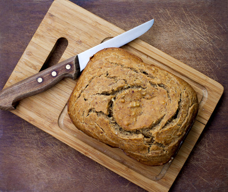 Homemade bread with knife on two wooden boards Stock Photo