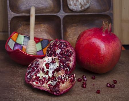 Still life shoot with pomegranates and honey