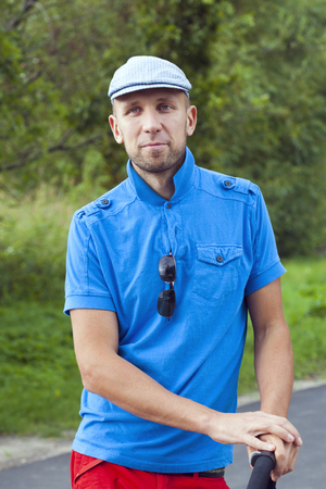 Portrait of a hipster young man in blue shirt