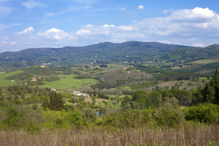 Spring landscape in Tuscan hills under blue sky