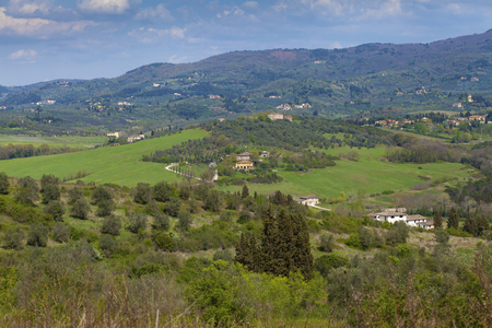 Idyllic rural hill landscape with old village houses in Tuscany Stock Photo