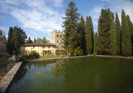 View of inner yard of Castello Verrazzano castle with an old pool and cypress trees (Tuscany, Italy) Editorial