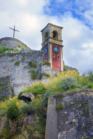 The view of time-battered clock tower in Kerkyra old fortress