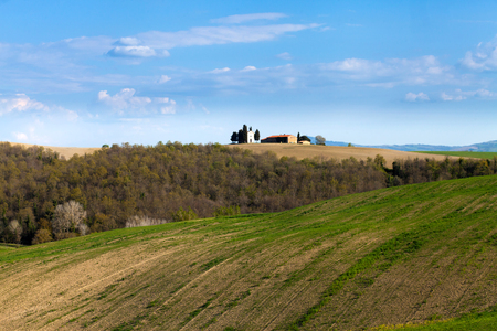 Idyllic landscape with lonely farm on the hilltop