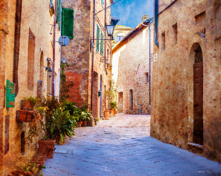 gully: Textured vintage grunge image of an old retro town street with old buildings and Mediterranean look Stock Photo