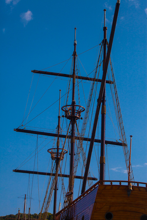 Underside view on an old sailing vessel (modern copy) ropes and gear against blue sky