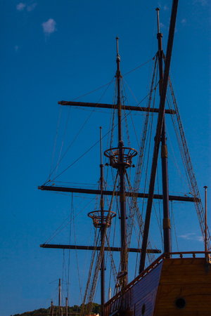 Masts of modern copy from an old wooden sailing ship Stock Photo