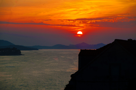 Setting sun and amazing sunset colors landscape with Adriatic sea