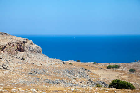 Serene Greek landscape with rocky coast and calm sea
