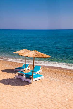 Two umbrellas on a beautiful empty beach