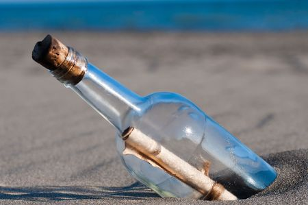Message in a bottle stranded on the beach  Stock Photo - 7782931