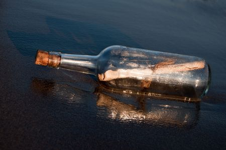 Message in a bottle stranded on the beach Stock Photo - 7782937