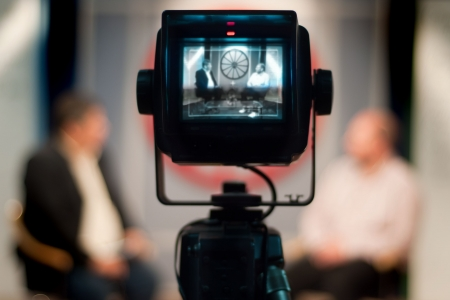 viewfinder: Video camera viewfinder - recording show in TV studio - focus on camera