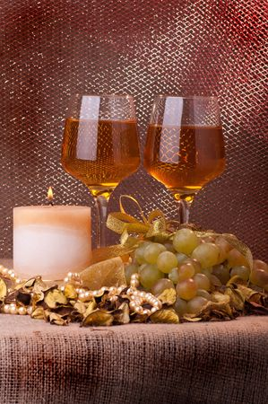 The glass of wine, white grapes and candle Stock Photo - 7979021