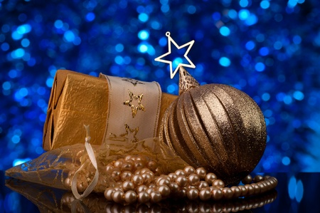 christmas decorations in gold tones - defocused blue light in  background Stock Photo - 8423821