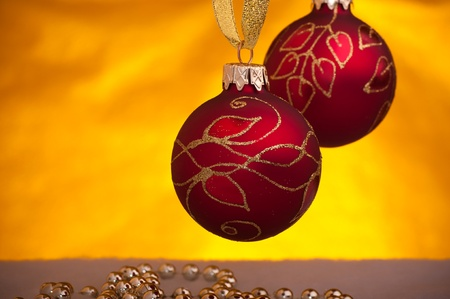 red christmas decorations - yellow light in  background Stock Photo - 8423784