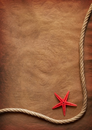 Aged Rope and starfish on the old paper background photo