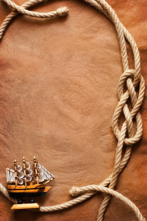 Aged Rope and ship on the old paper background