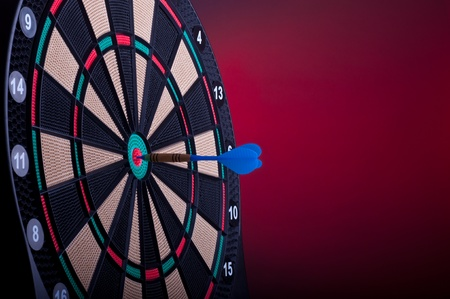 close up of an electronic dart board and blue arrow photo