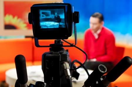 Video camera viewfinder - recording show in TV studio - focus on camera Stock Photo - 9163157