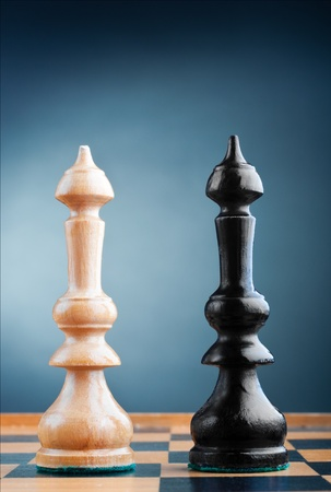 two chess kings on the chessboard, blue background photo