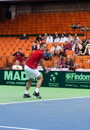 NOVI SAD, SERBIA - MAR 6 : Serbia tennis player, singles ranking 12 Viktor Troicki during his Davis Cup, 2011 World Group singles match vs. Somdev Devvarman, Marth 6, 2011 in Novi Sad, Serbia