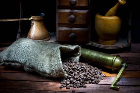 cezve: Vintage coffee grinder and cezve with roasted coffee beans