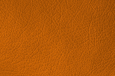 Orange leather texture closeup, useful as background photo