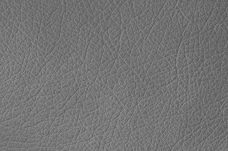 Gray leather texture closeup, useful as background Stock Photo