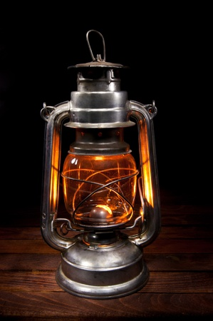 Antique Oil Lamp Lighting up the Darkness Stock Photo - 11881648