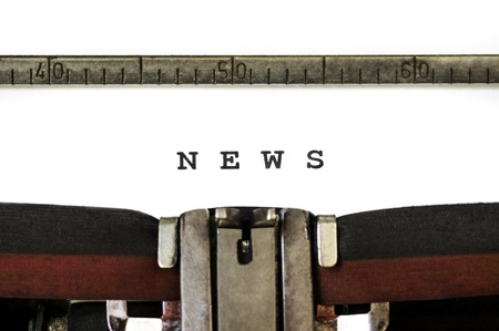 The word News printed on an old typewriter